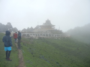 The temple appears out of the fog!